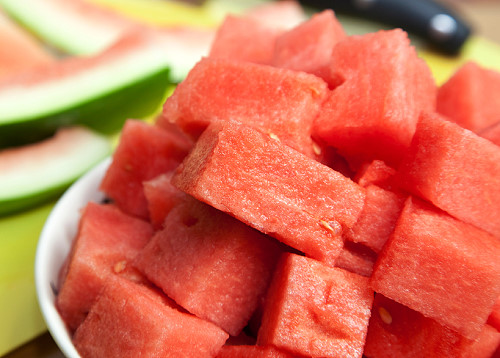 Closeup bowl of watermelon on a bench